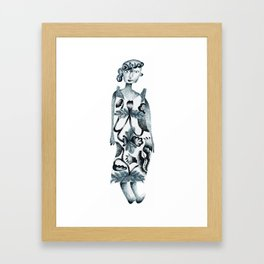 Woman wearing a batik Framed Art Print