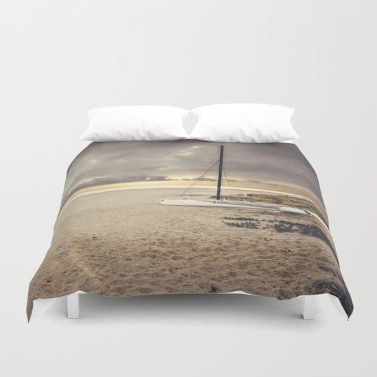 Dramatic sunrise on the beach Duvet Cover