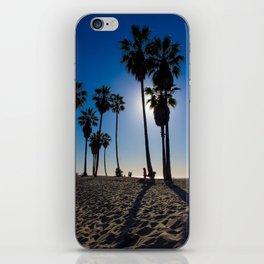 Sun on palm tree iPhone Skin