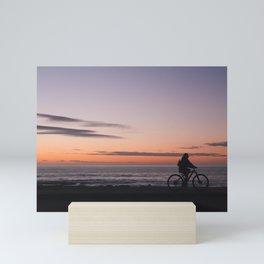 Girl on a bicycle Mini Art Print