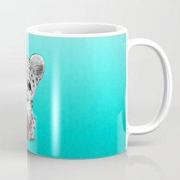 Snow Leopard Cub Playing With Basketball Coffee Mug