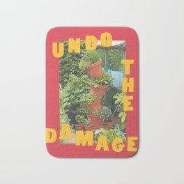 undo the damage Bath Mat