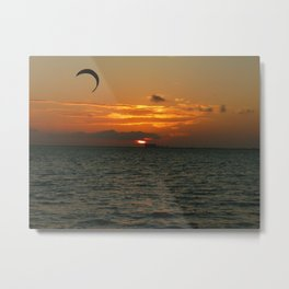 Sunset in the calm sea with red sky, gray cloud and a parachute Metal Print