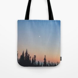 High Moon over Silhouetted Trees at Dusk Tote Bag