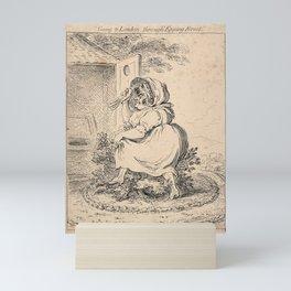 A voluminous woman crossing a bush in a circle of foliage to get to a latrine; perhaps representing Mini Art Print