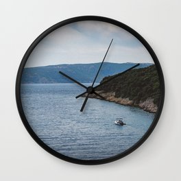 Boat leaving Valbiska bay Wall Clock
