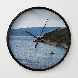 Boat leaving Valbiska bay Wall Clock