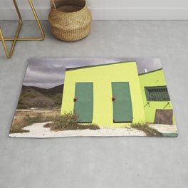 Lime green Caribbean building Rug