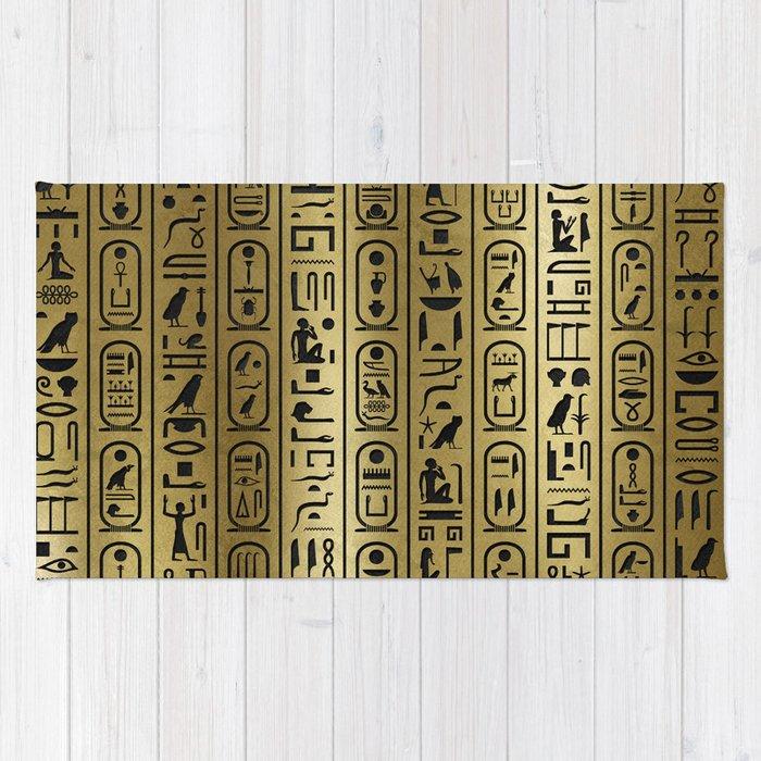 Black hieroglyphs pattern on Ancient Gold Rug
