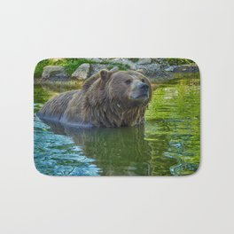 Brown bear in water Bath Mat