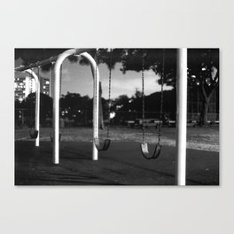 swings at night Canvas Print