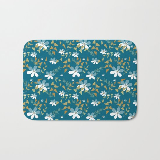 White flowers on a blue background . Bath Mat