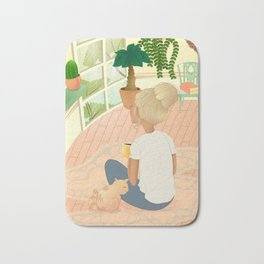 girl with cat relaxing at home looking out the window Bath Mat