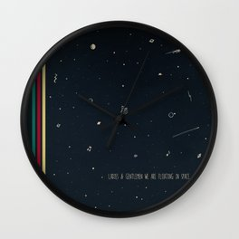 We are floating in space Wall Clock