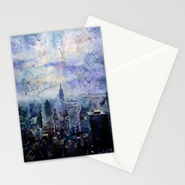 Watercolor batik painting of Empire State building rising above buildings of New York City Stationery Cards
