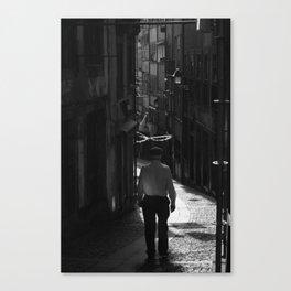 Man walking the streets Canvas Print