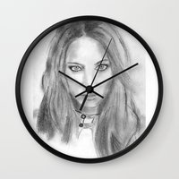 katniss Wall Clocks featuring Katniss by S'ANNie