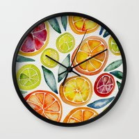 watercolor Wall Clocks featuring Sliced Citrus Watercolor by Cat Coquillette