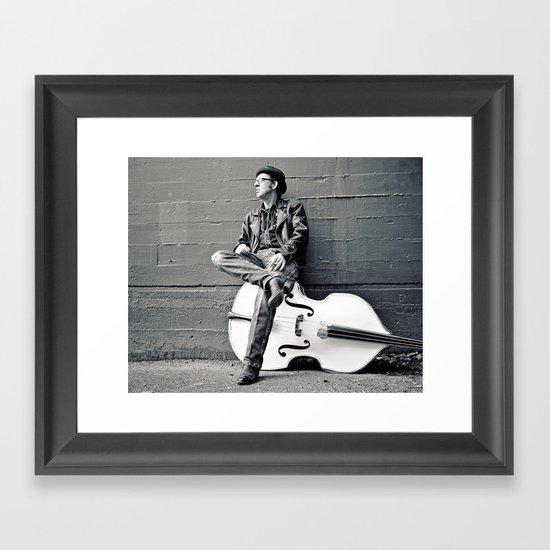 Bass player on break Framed Art Print