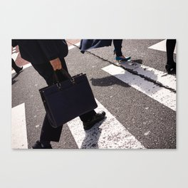Group of businessmen and women walk along crosswalk in Shinjuku, Tokyo, Japan Canvas Print