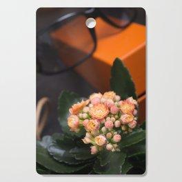 lady set with orange flower Cutting Board