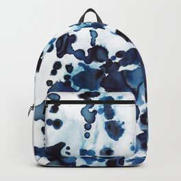 Large waves and sea spray. Backpack
