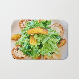 Salad arugula leaves with cheese and orange slices Bath Mat