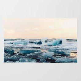 Waves Crashing on the Ice of Diamond Beach, Iceland at Sunset Rug