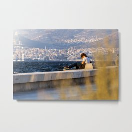 Girl sitting on a bench at seaside in Izmir (Turkey) Metal Print