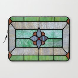 Stained Glass features a picture of a classic stained glass window typically found above a door Laptop Sleeve