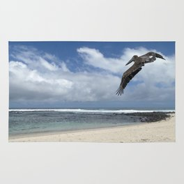 Pelican above the beach Rug