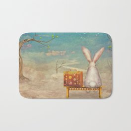 Sad rabbit  with suitcase sitting on the bench on the cloud in sky  Bath Mat
