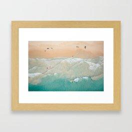 Beachgoers from above Framed Art Print
