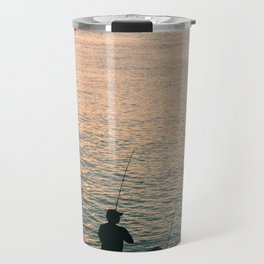 Three fisherman enjoy a beautiful sunset at the shore of 'Colonia del Sacramento, Uruguay'. Travel Mug