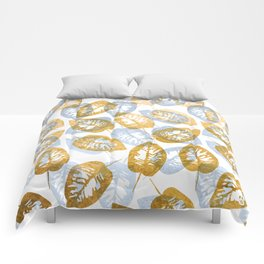 Blue and gold leaves pattern Comforters