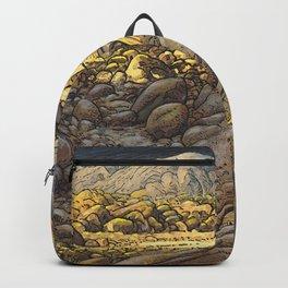 Rocky desert at sunset Backpack