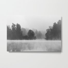 Trees disappearing in morning fog above the lake Metal Print
