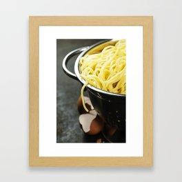 spaghetti in colander on dark vintage background Framed Art Print