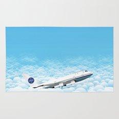 Plane through clouds Rug