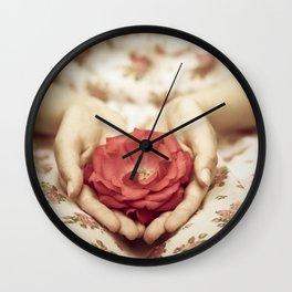 Rose in her hands II Wall Clock