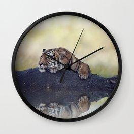 Bengal tiger resting on a rock near pond Wall Clock