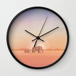Elephants journey through desert landscapes of Africa Wall Clock