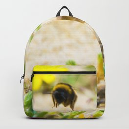 the flight of bumble bee on the bunes Backpack