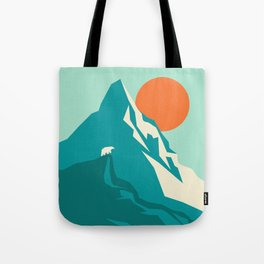 As the sun rises over the peak Tote Bag