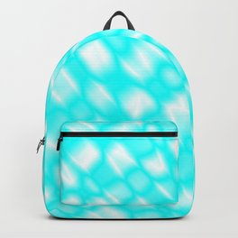 Splashes of paint in a light blue diagonal with cracks on the plastic film. Backpack
