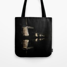 Floating illuminated windmills in the night Tote Bag
