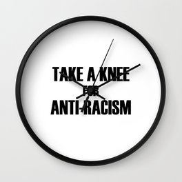 take a knee for anti racism Wall Clock