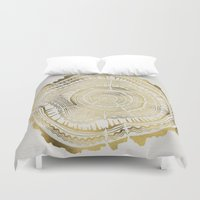 bianca green Duvet Covers featuring Gold Tree Rings by Cat Coquillette