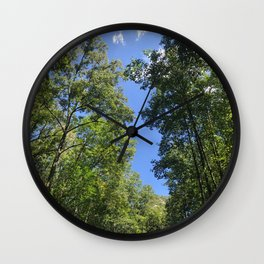 Trees and the sky Wall Clock