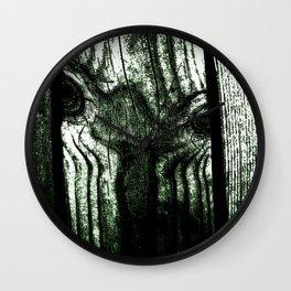 Freak in a tree Wall Clock